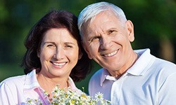 Senior man and woman smiling together outdoors