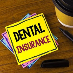 Dental insurance written on post it note