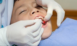 Child receiving emergency dental treatment