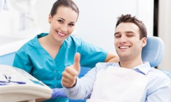 Smiling patient in dentist chair