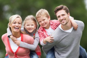 smiling family seeing family dentist
