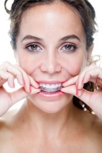 Your dentist in Greenfield looks at the benefits and differences between Invisalign and Six Month Smiles.